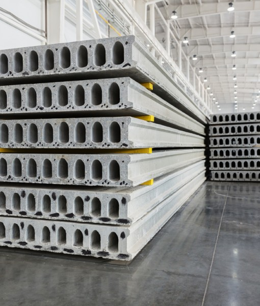 Stack of precast reinforced concrete slabs in a house-building f